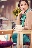 Woman drinking coffee in a cafe on the streets. Of Paris Royalty Free Stock Images