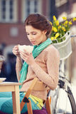 Woman drinking coffee in a cafe. On the streets of Paris Stock Image