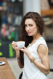 Woman drinking coffee in a cafe supermarket. Royalty Free Stock Image