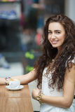 Woman drinking coffee in a cafe supermarket. Stock Image