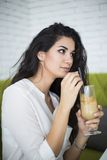 Woman drinking coffee in cafe Stock Photography