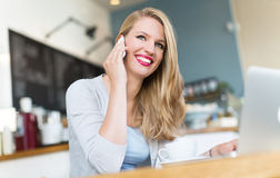 Woman drinking coffee at cafe Stock Photos