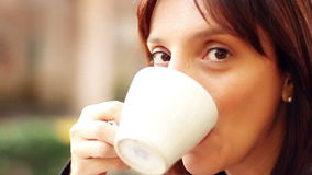 Woman drinking coffee stock footage