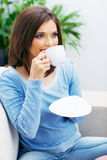 Woman drinking coffee,  close up face Royalty Free Stock Photography