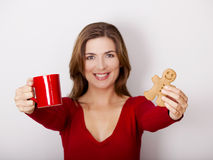 Woman drinking coffee with cookies Stock Images