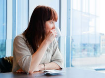 Woman drinking coffee at a corporate restaurant Royalty Free Stock Photos