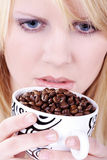 Woman drinking from coffee cup beans Stock Images