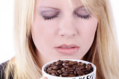 Woman drinking from coffee cup beans Stock Image