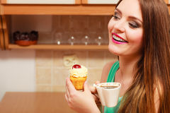 Woman drinking coffee and eating delicious cake. Stock Photos