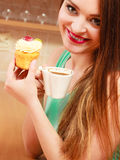 Woman drinking coffee and eating delicious cake. Royalty Free Stock Photography