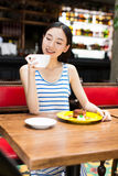 Woman drinking coffee and having breakfast. Stock Image