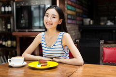 Woman drinking coffee and having breakfast. Stock Photography