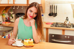 Woman drinking coffee and having breakfast. Stock Images