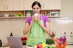 Woman drinking coffee in her kitchen Royalty Free Stock Photo