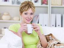 Woman drinking coffee at home Royalty Free Stock Image