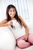 Woman drinking coffee at home Royalty Free Stock Images