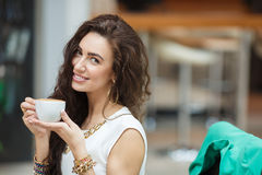 Woman drinking coffee at home, with the Sunrise Royalty Free Stock Photography