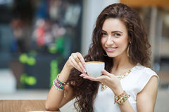 Woman drinking coffee at home, with the Sunrise Royalty Free Stock Images