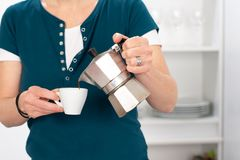Woman is drinking coffee in the kitchen Stock Image