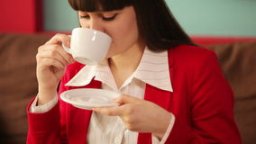 Woman drinking coffee and laughing at camera stock footage