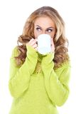 Woman drinking coffee while looking aside Stock Photos