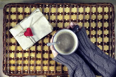 Woman drinking coffee and looking at the card Valentine`s Day Royalty Free Stock Image