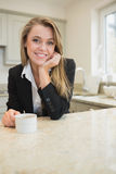 Woman drinking coffee at morning Stock Images