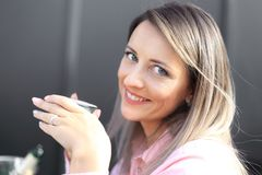 Woman drinking coffee in the morning at restaurant soft focus on the eyes. Woman drinking coffee in the morning at restaurant Stock Photography