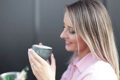 Woman drinking coffee in the morning at restaurant soft focus on the eyes. Woman drinking coffee in the morning at restaurant Royalty Free Stock Image