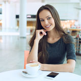 Woman drinking coffee in the morning at restaurant soft focus. royalty free stock photos