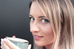 Woman drinking coffee in the morning at restaurant soft focus on the eyes. Woman drinking coffee in the morning at restaurant Royalty Free Stock Photos