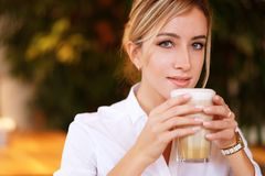 Woman drinking coffee in the morning at restaurant Stock Photo