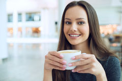 Woman drinking coffee in the morning Stock Photos
