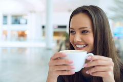 Woman drinking coffee in the morning Stock Image