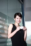 Woman drinking coffee at office royalty free stock photos
