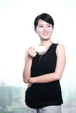 Woman drinking coffee at office Stock Image