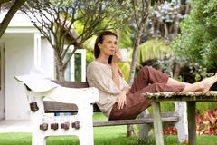 Woman drinking coffee outdoors in garden Royalty Free Stock Photography