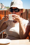 Woman drinking coffee outdoors Royalty Free Stock Images