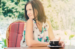 Woman drinking coffee outdoors Stock Image