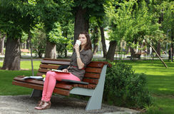 Woman Drinking Coffee in a Park Royalty Free Stock Photos