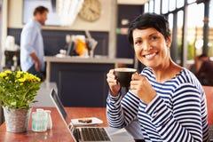 Woman drinking coffee, portrait Stock Photo