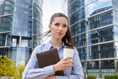 Woman drinking coffee and reading her touchscre Stock Photos