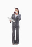 A woman drinking a coffee and reading a newspaper. Businesswoman drinking a coffee and reading a newspaper against white background Royalty Free Stock Photos