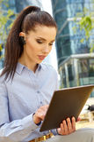 Woman drinking coffee and reading tablet Stock Photo