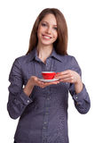 Woman drinking coffee from a red cup Royalty Free Stock Images