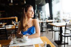 Woman drinking coffee in restaurant. Beautiful woman drinking coffee in restaurant Stock Images