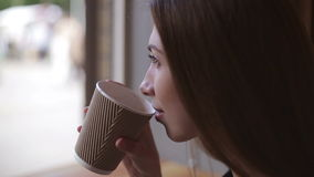 Woman drinking coffee in restaurant or cafe stock video