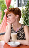 Woman drinking coffee in restaurant Stock Photography