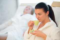 Woman drinking coffee at spa Royalty Free Stock Photography