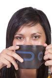 Woman Drinking Coffee Standing Up Stock Image